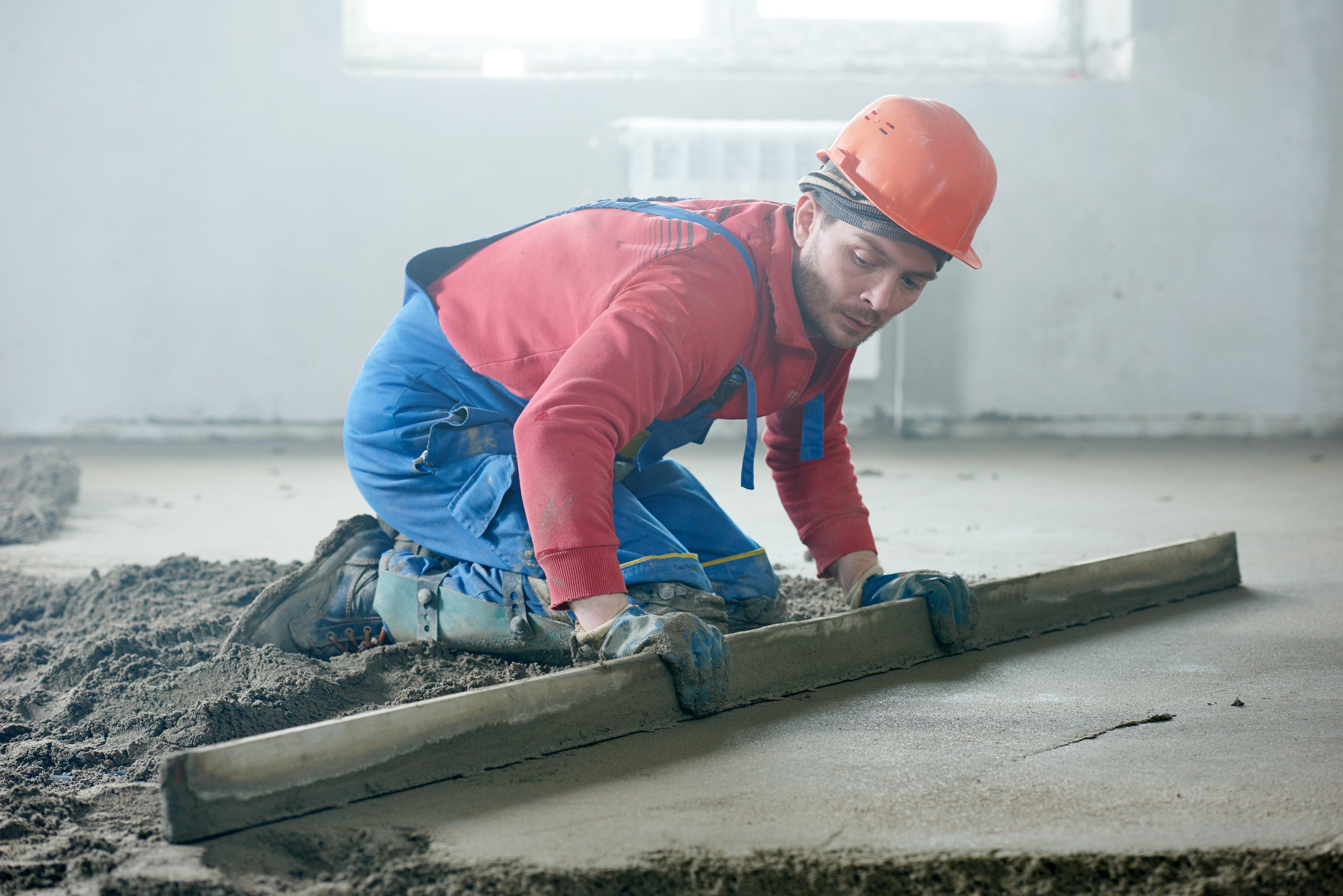builder screeding a floor