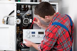 Plumber fixing heating unit