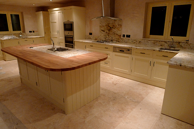 Natural wood and marble kitchen installation