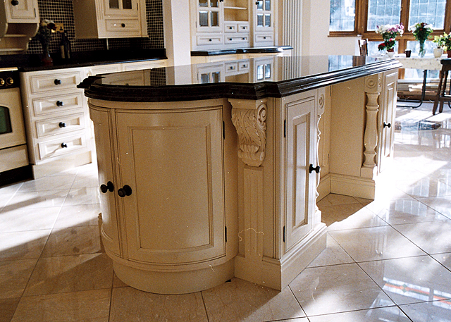 Wooden kitchen island with marble counter top