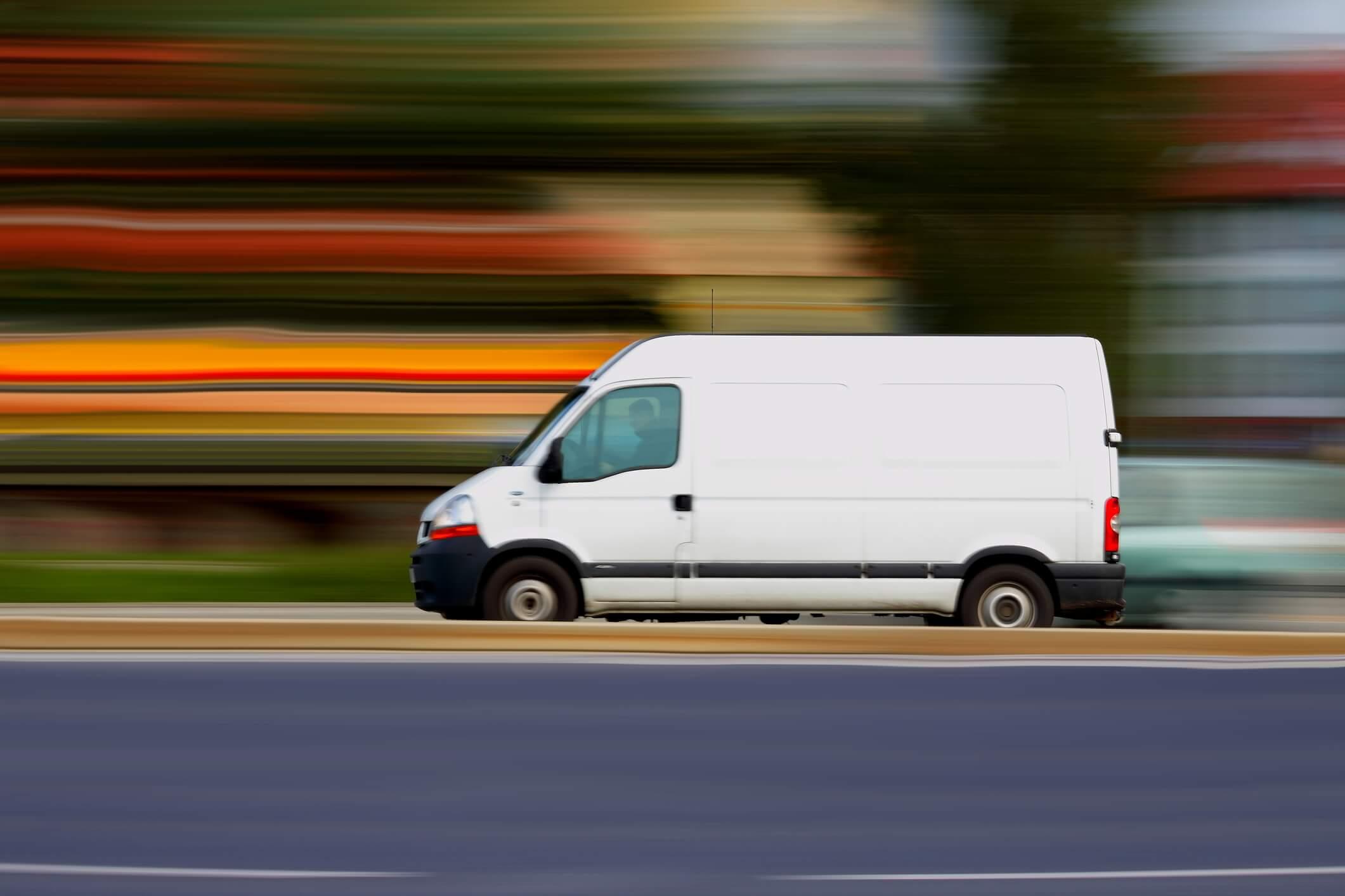 Van driving down road, motion blur of speed.