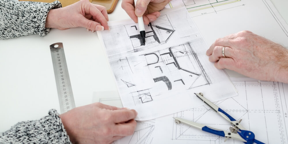Architect Showing Client the Plans