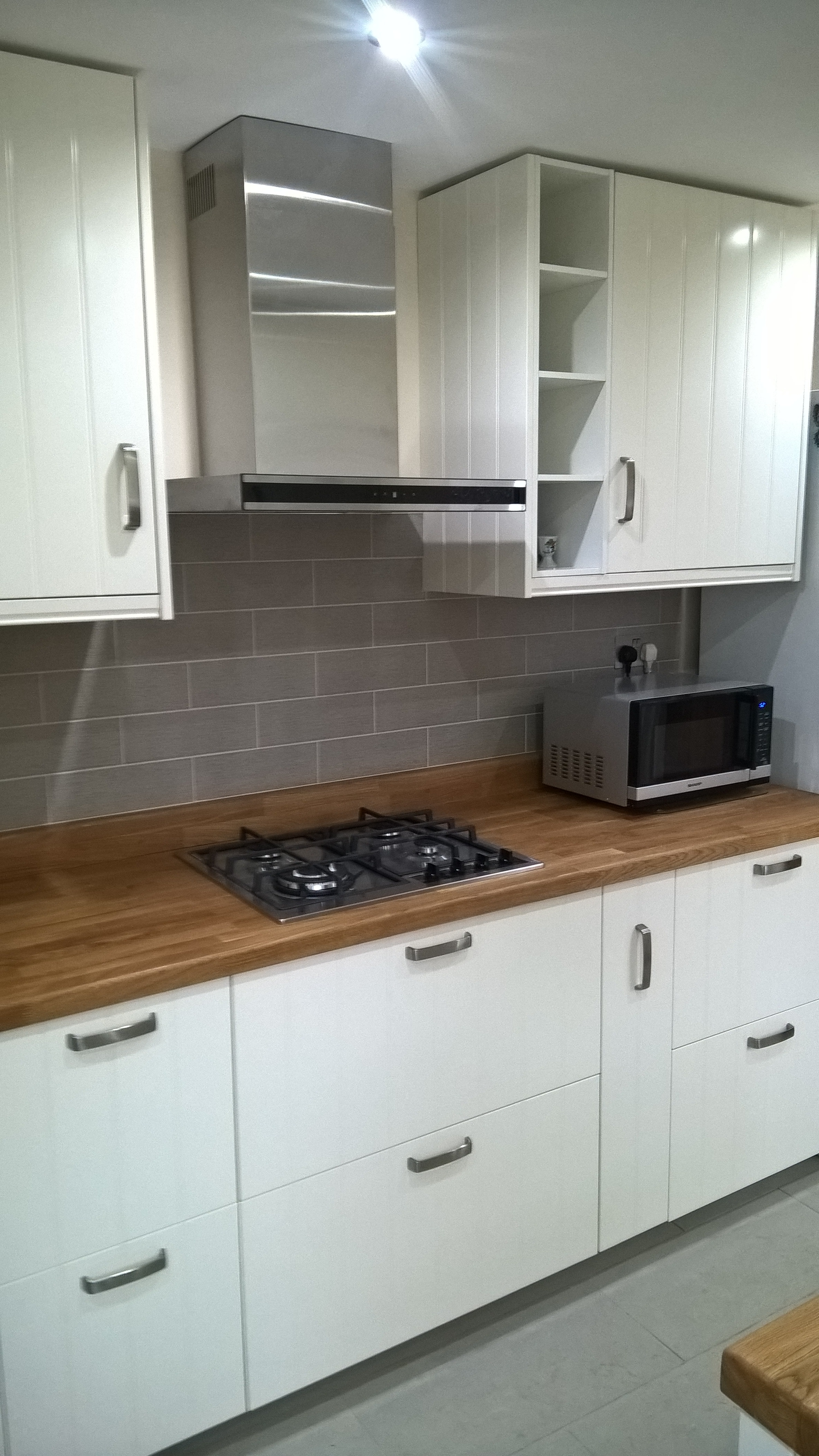 Newly built countertop, cupboards and stove