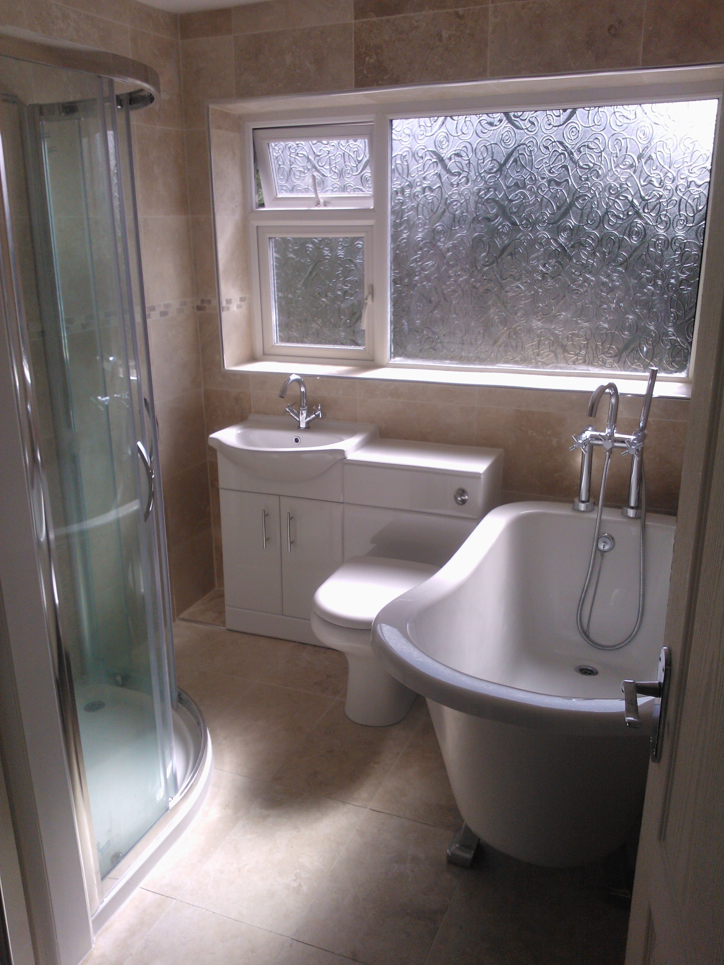 new bathroom with bath, shower, sink and toilet.