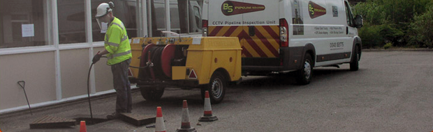 B&S Pipeline Solutions Ltd Employee Clearing a Drain.