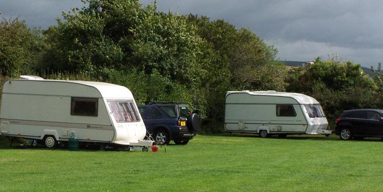 Caravans parked in field