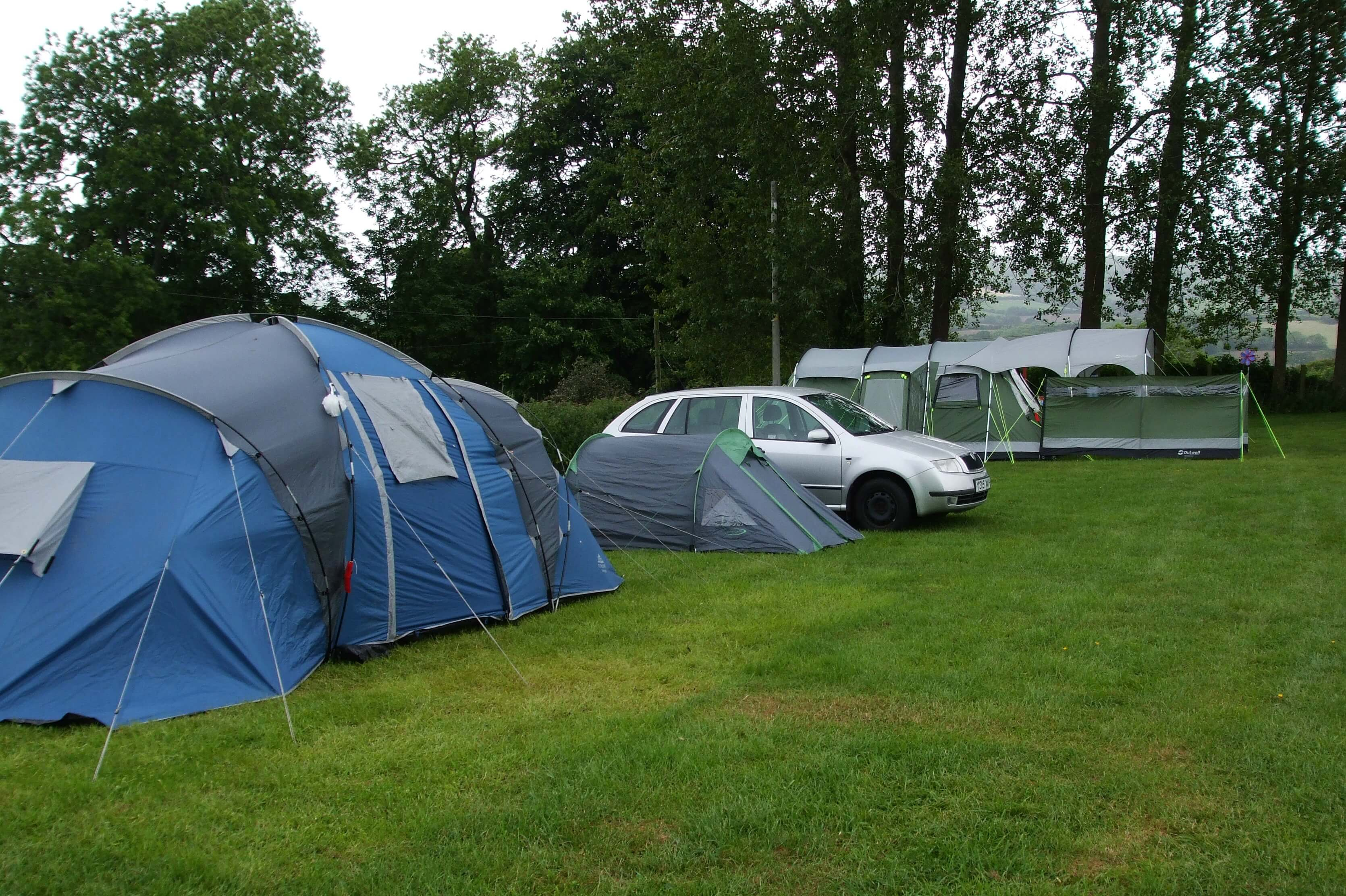 Car and tents set up in field