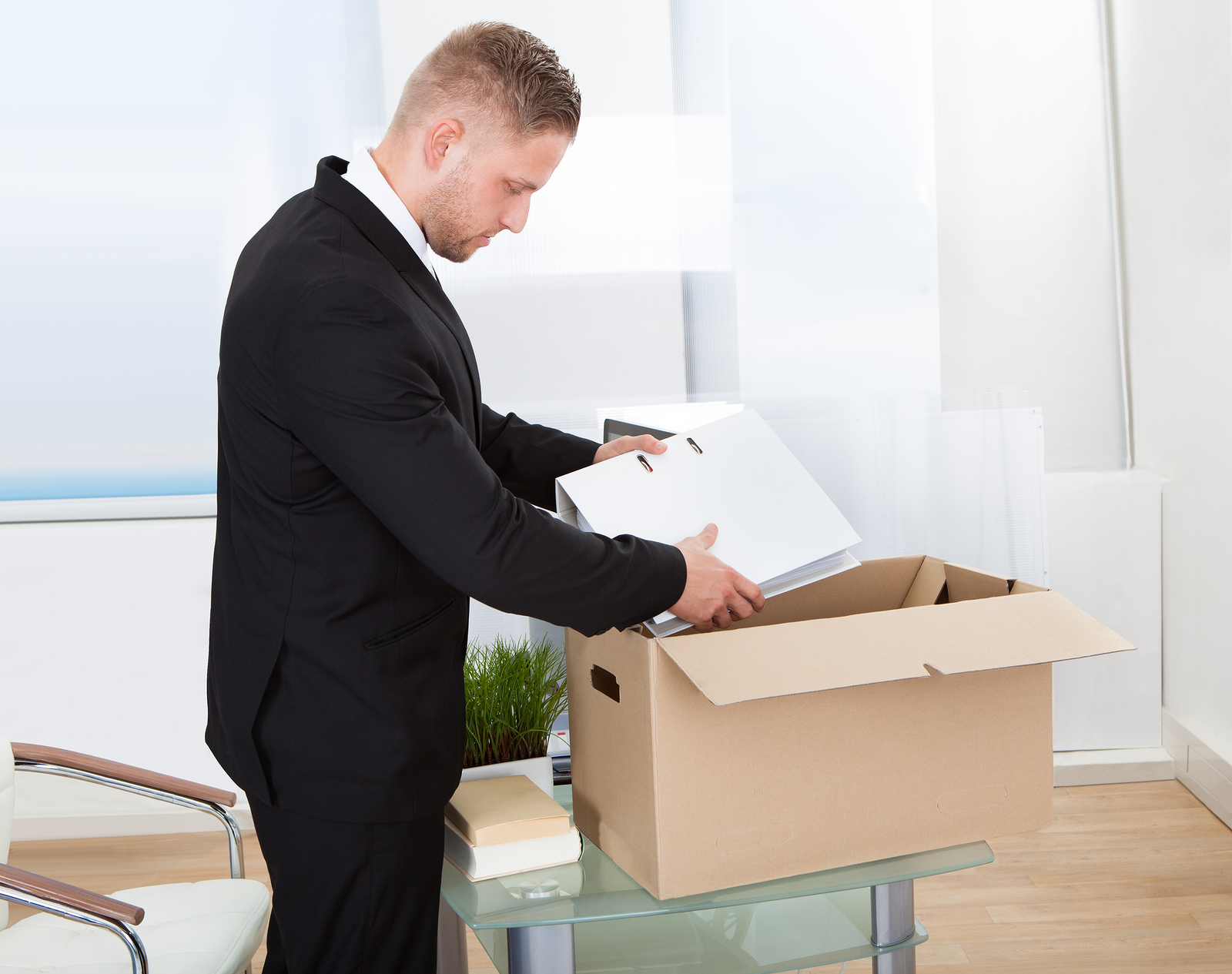 Person gathering personal belongings after being made redundant