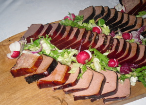 platter of various pates on a chopping board