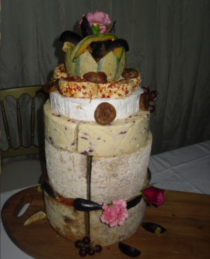 cheese tower - various different cheeses tacked on top of each other