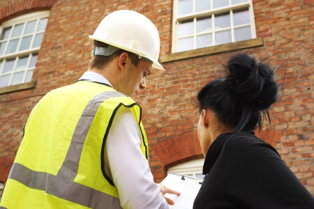 Surveyor carrying out a home purchase survey for new homeowner