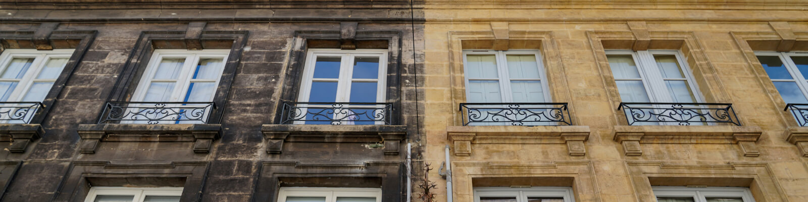 An Outside facades renovation of old building before and after difference between wash clean and dir