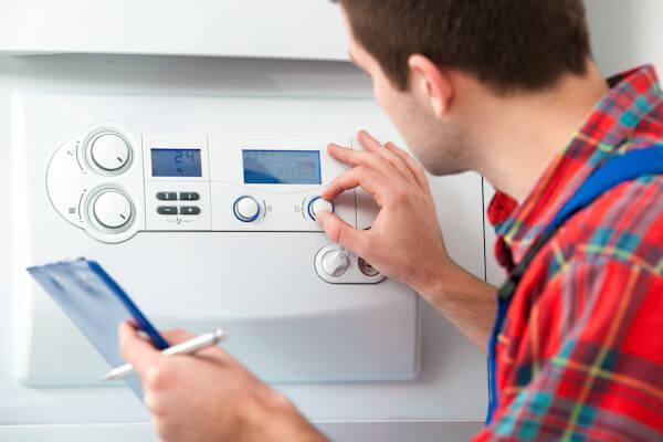 Man servicing boiler
