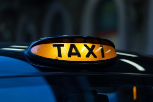 Close-up photo of illuminated taxi sign