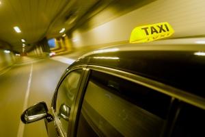 Taxi drives through tunnel