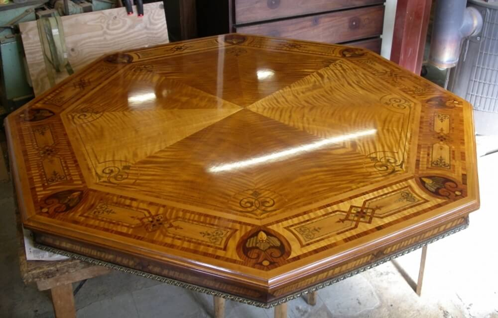 A brown wooden table that was water damaged has been restored