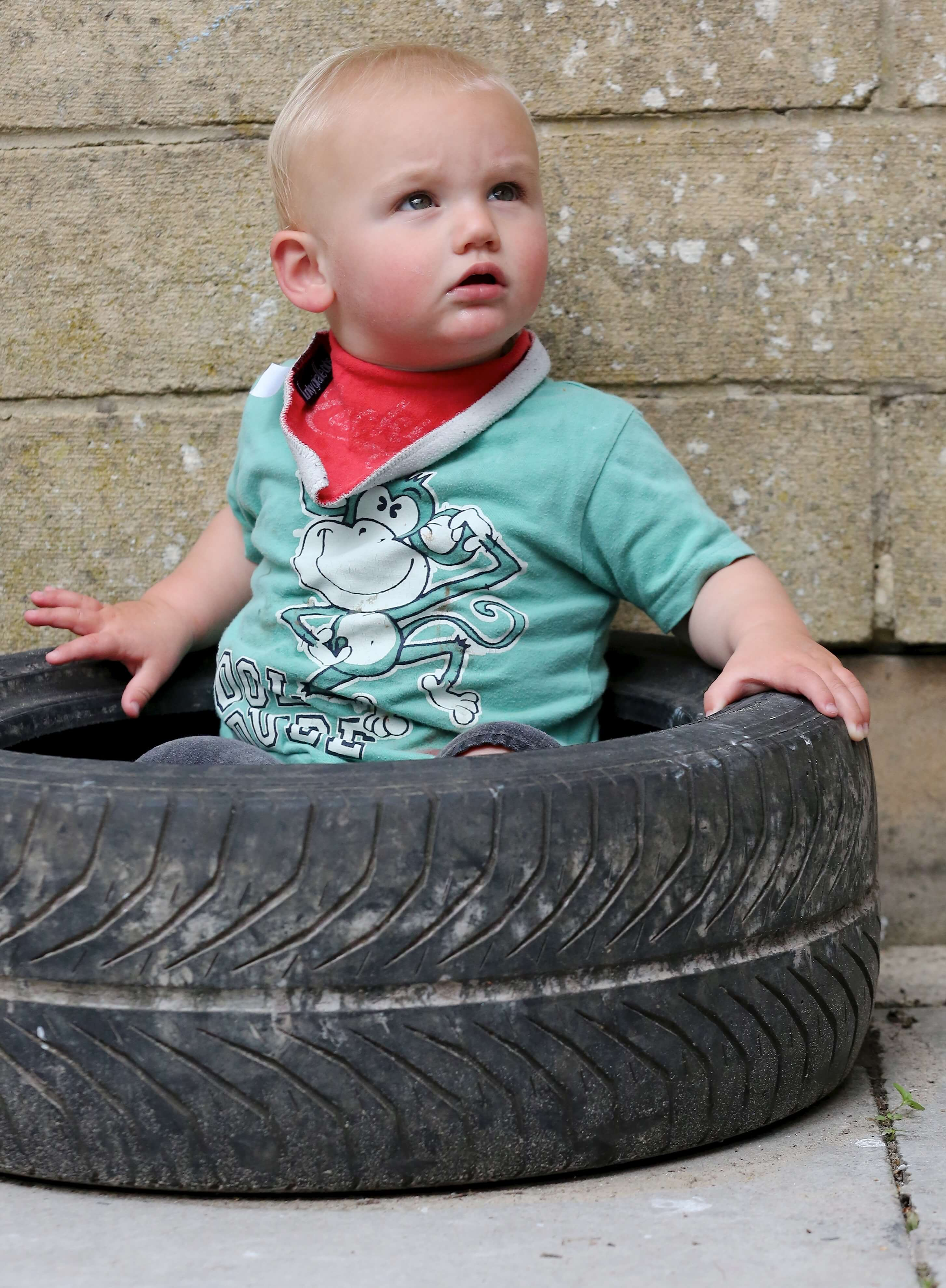 Little Willows Nursery member playing in a tyre