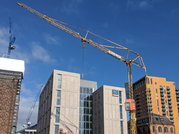 mobile tower crane elevated over buildings