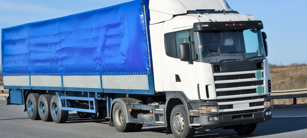 A Courier Truck with a Blue Cargo Bed