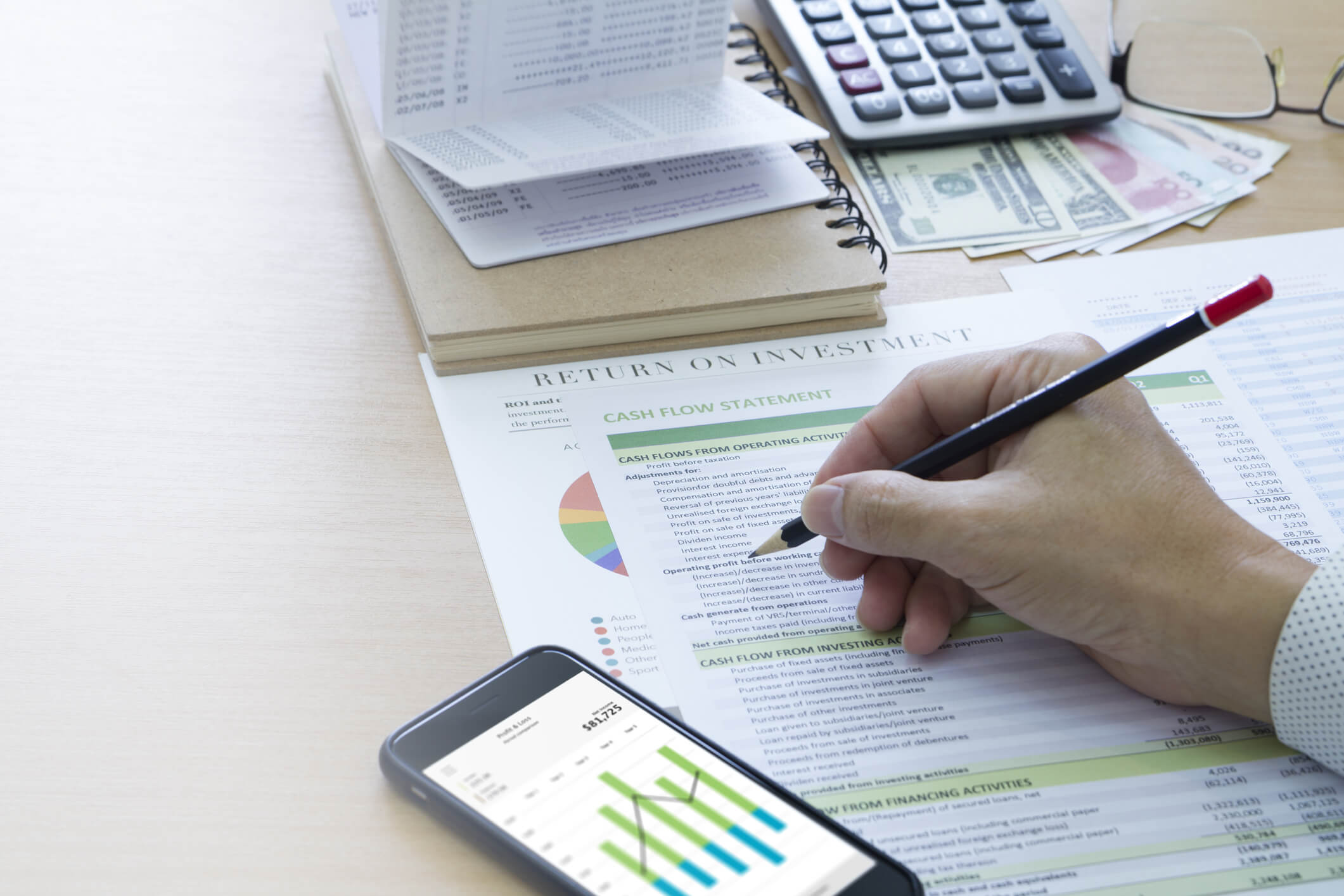 Businessman analysing saving deposit bank account in cash flow statement management.