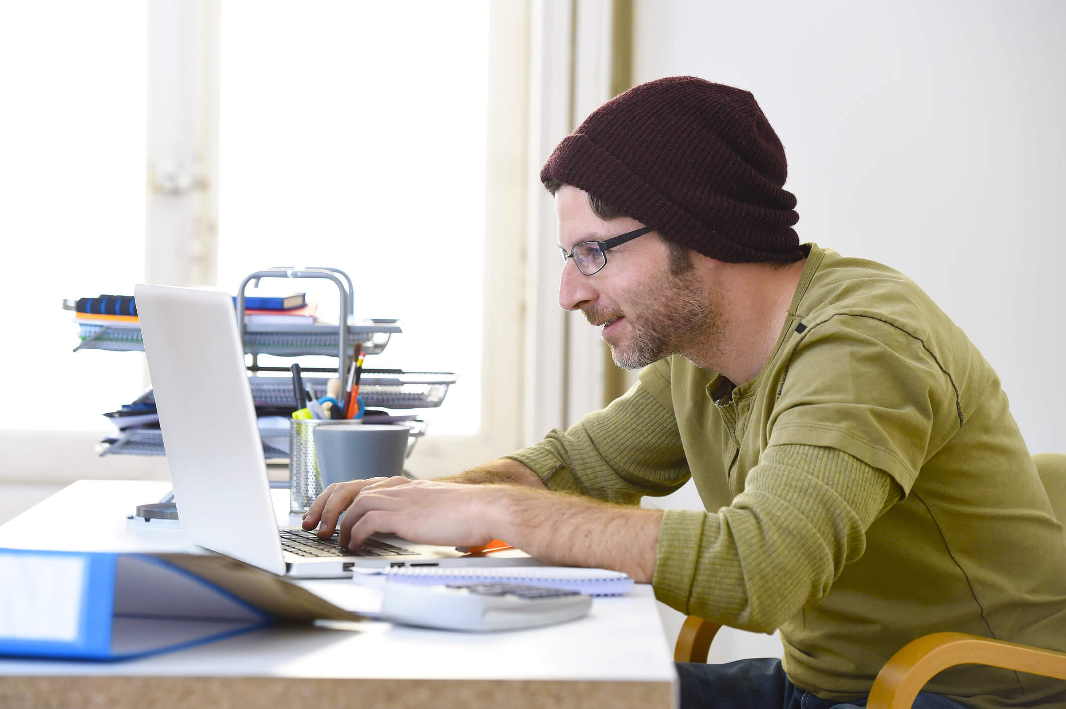 Self employed man working at desk.
