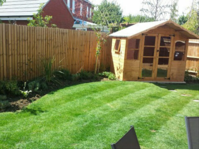 A Modern Garden with a Shed at the Bottom of it.