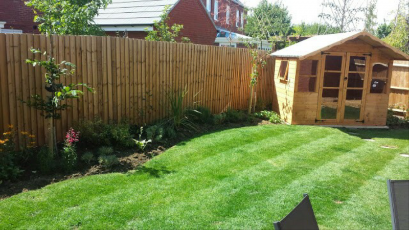 A Well Maintained Garden with a Modern Shed.