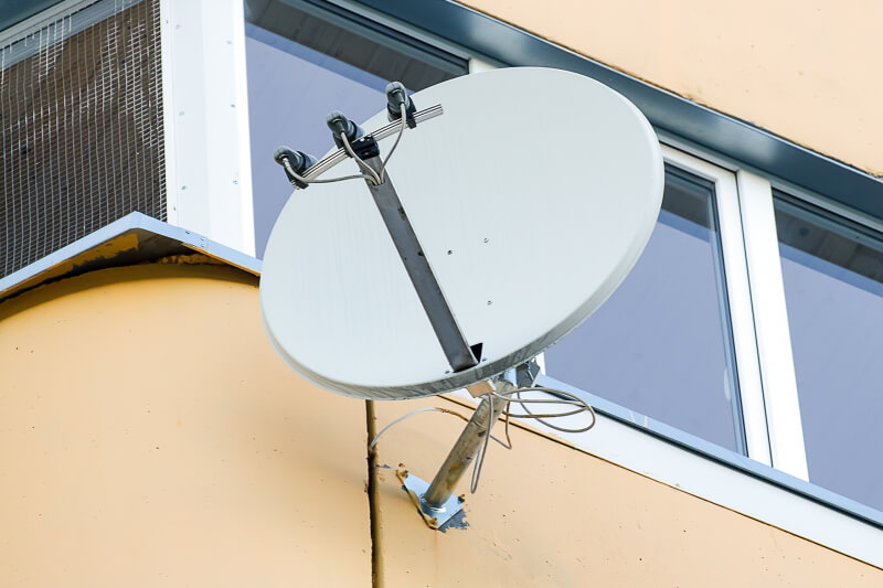 TV Satellite installed on the side of a building