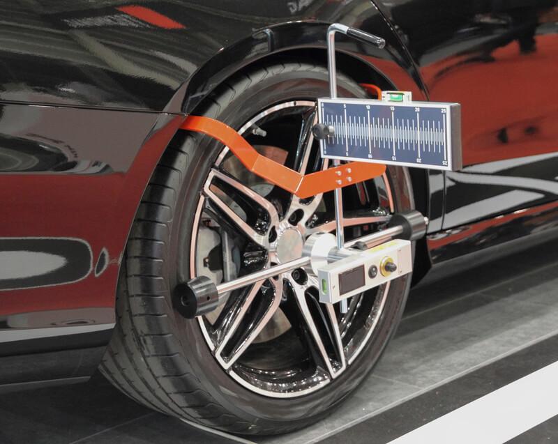 Car wheels being aligned