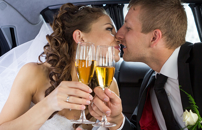 Just married couple in back of car