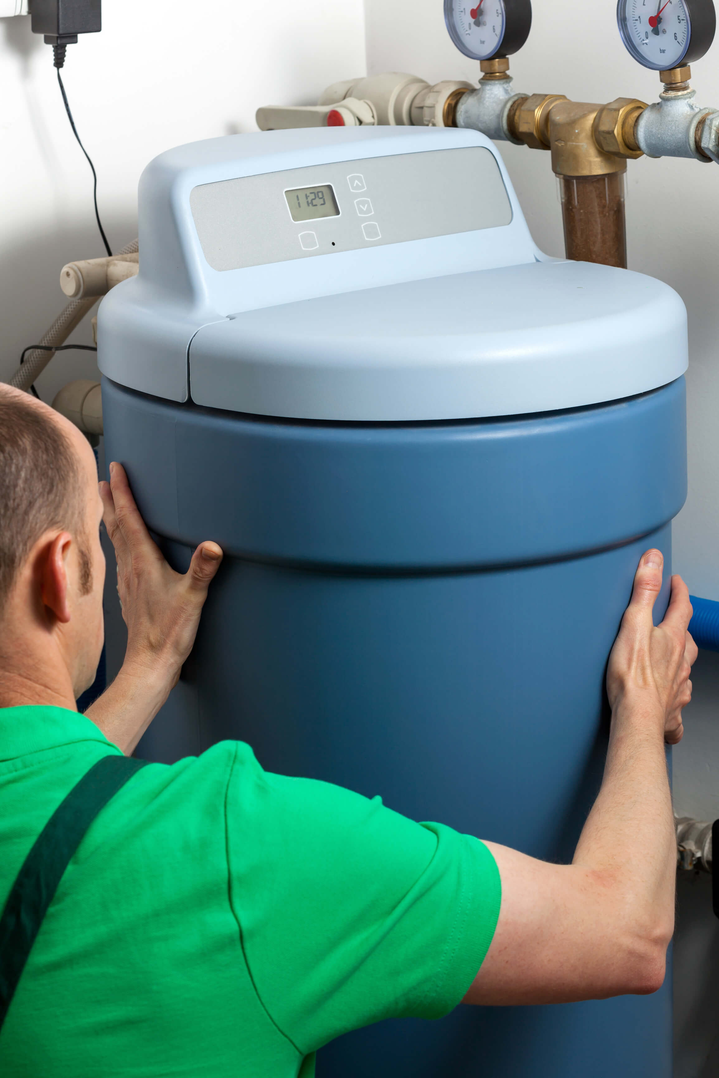 A man fitting a water softener