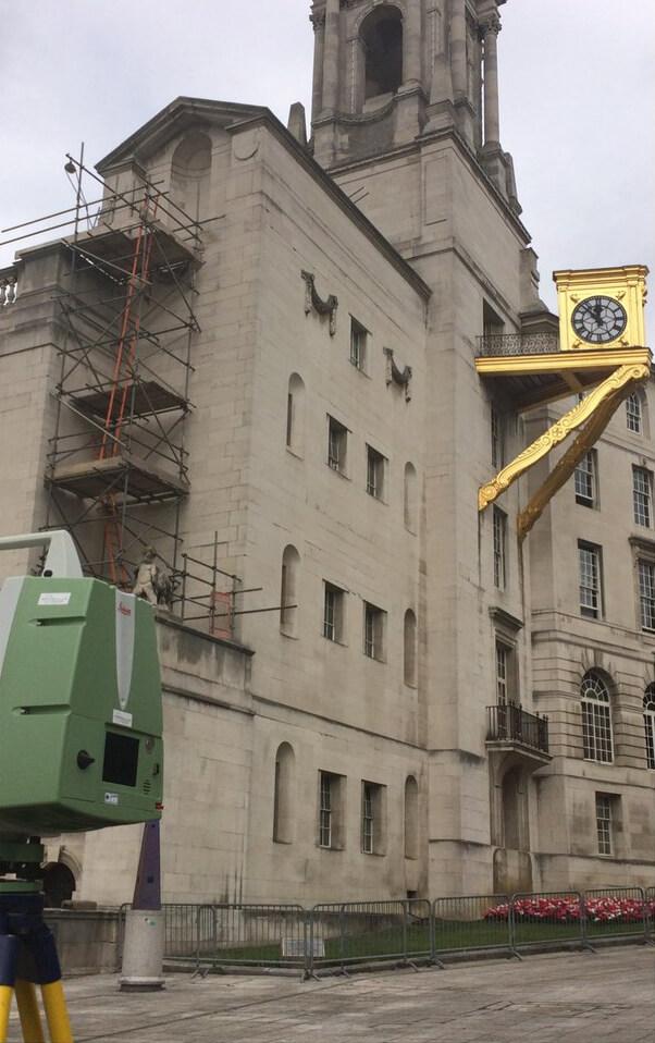 Camera scanning building.