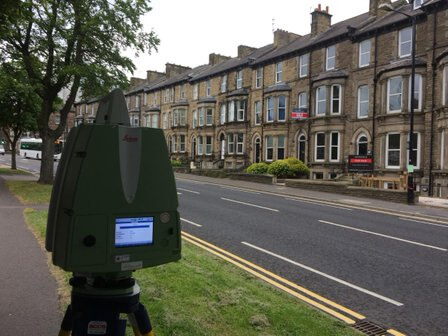 Camera scanning detached houses.