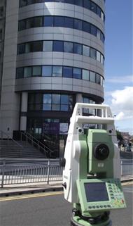 Camera scanning modern building.