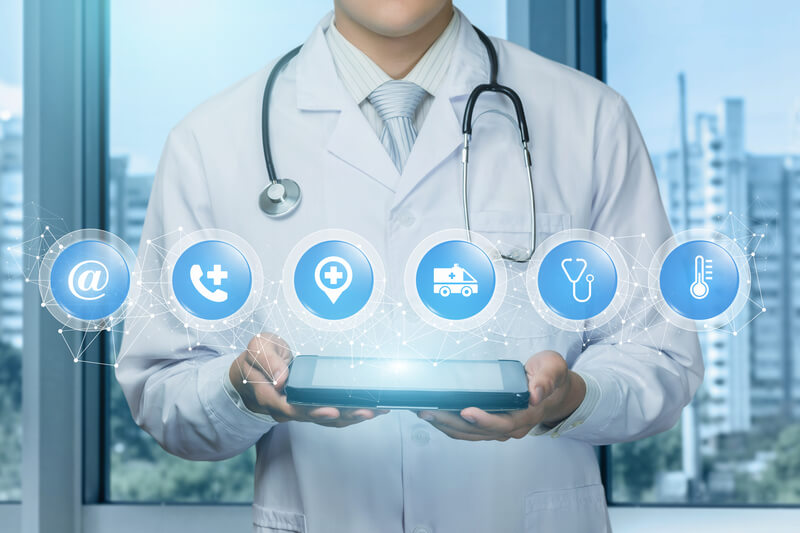 Doctor shows contact icons emergency medical care in network