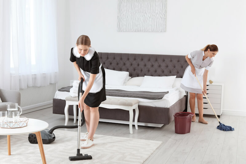 Professional cleaners cleaning floor
