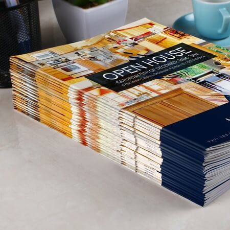 A stack of brochures for an open house.
