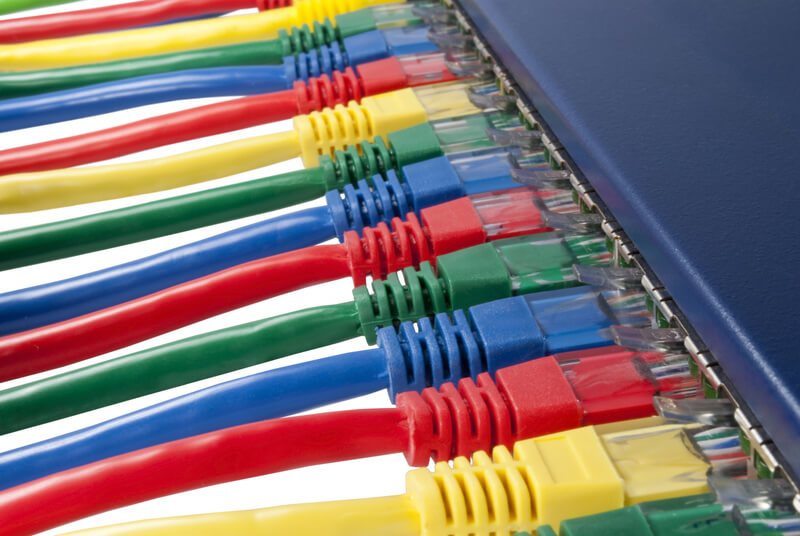 Variety of Different Coloured Ethernet Cables plugged into a Router