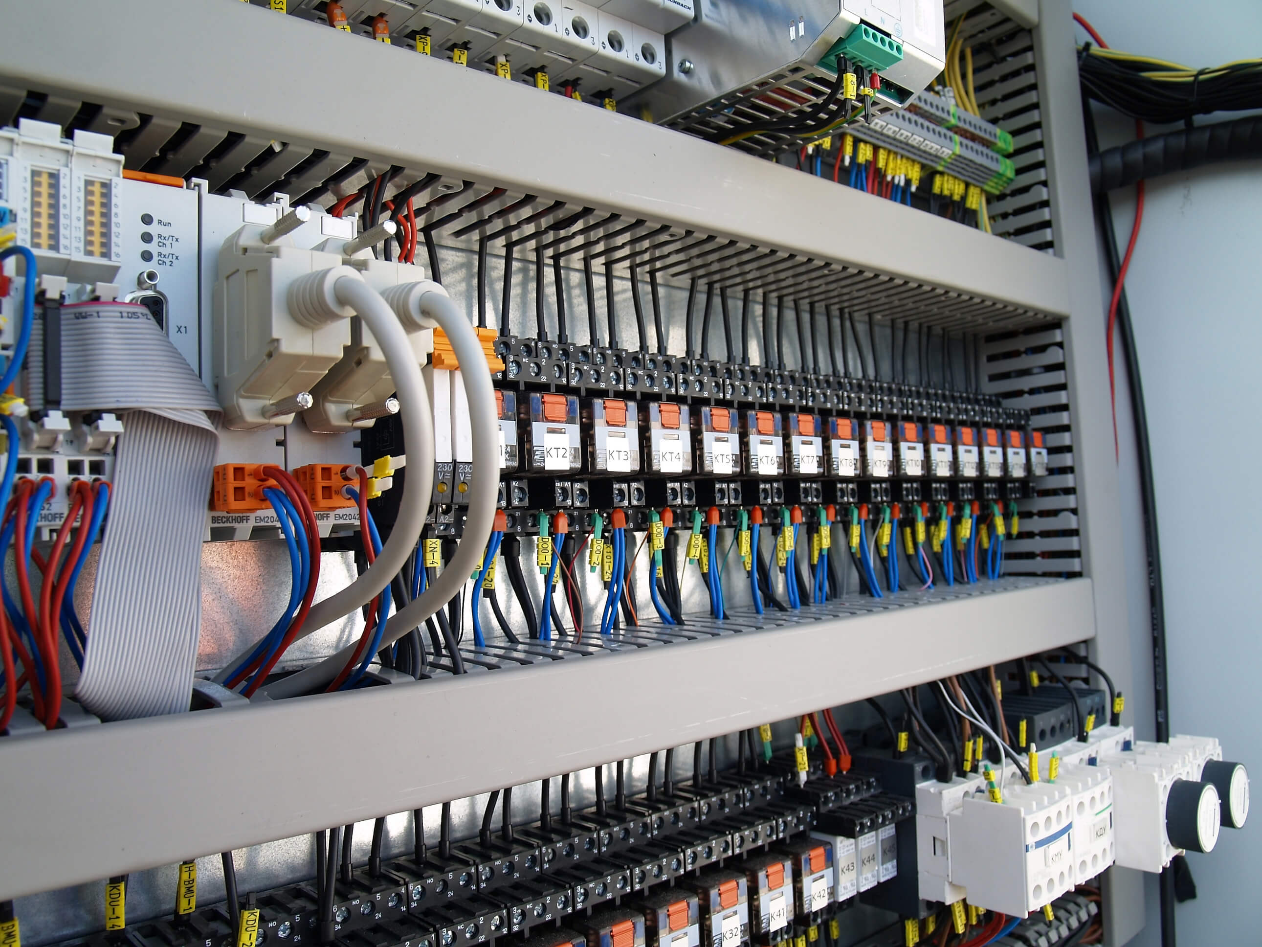Electrician hands installing wires in electrical wall fixture - closeup