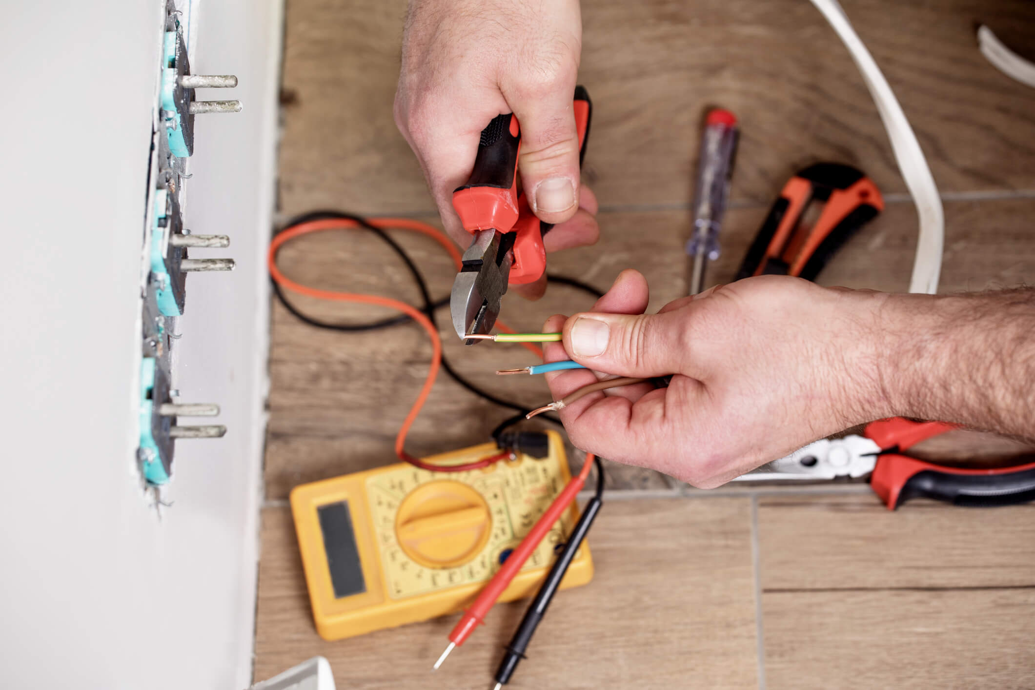 Electrician at work, home renovation, electrical installation, Hand of an electrician, handyman at work.