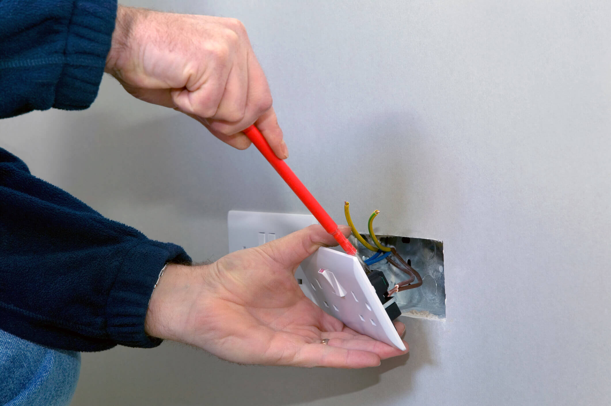 Electrician installing a socket.