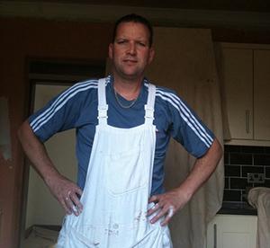 Decorater stood in kitchen.