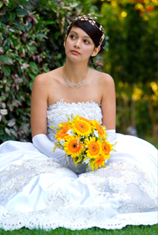 Bride sitting on the floor with a tiara on.