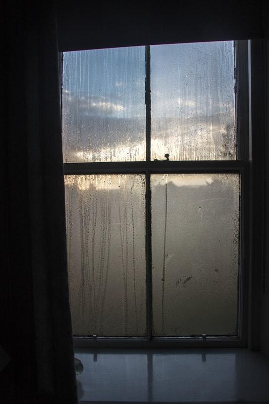 Single Glazed Window with Condensation