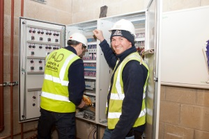 electricians repairing electrical cabinet
