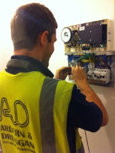 Electrician testing for electrical faults