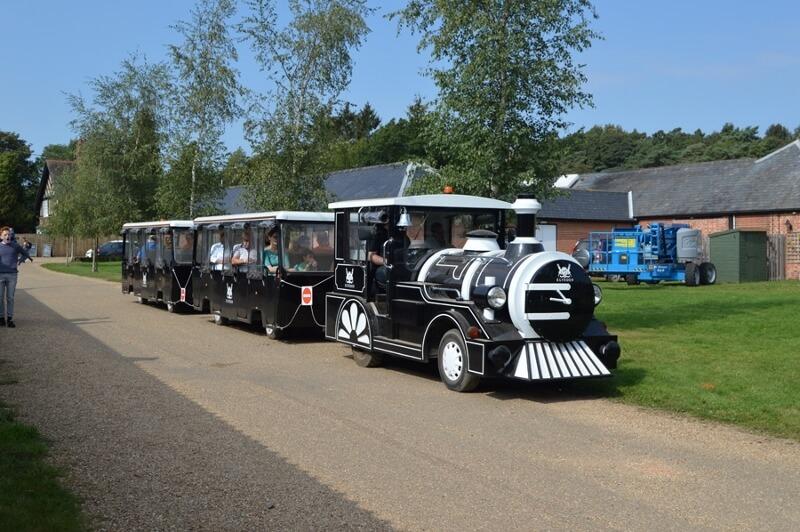 Modern Black Land Train with Passengers