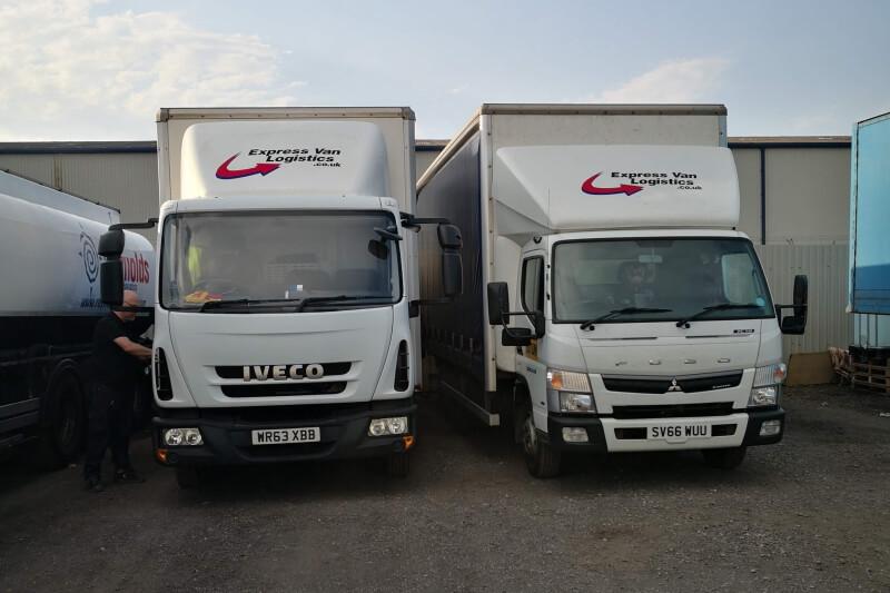 Express Van Logistics Trucks in Depot.