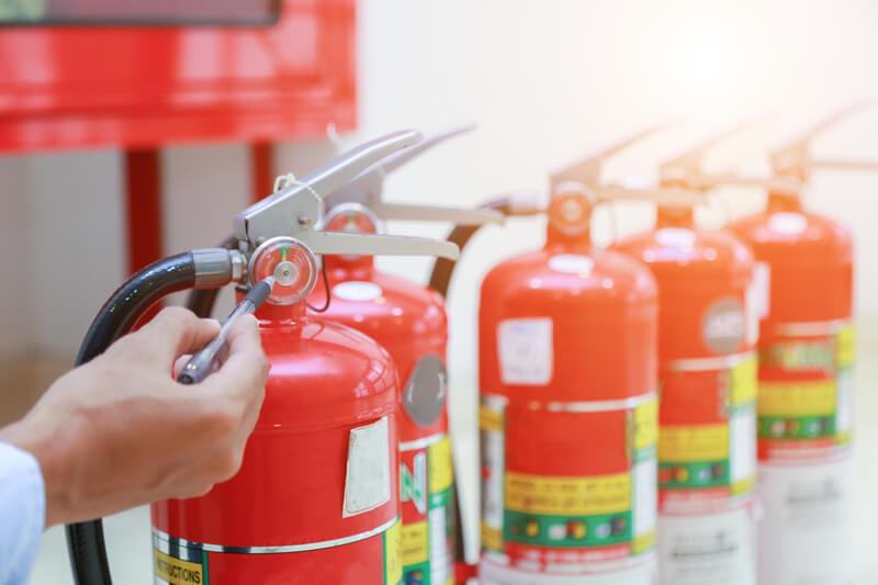 An inspector checking the fire extinguishers