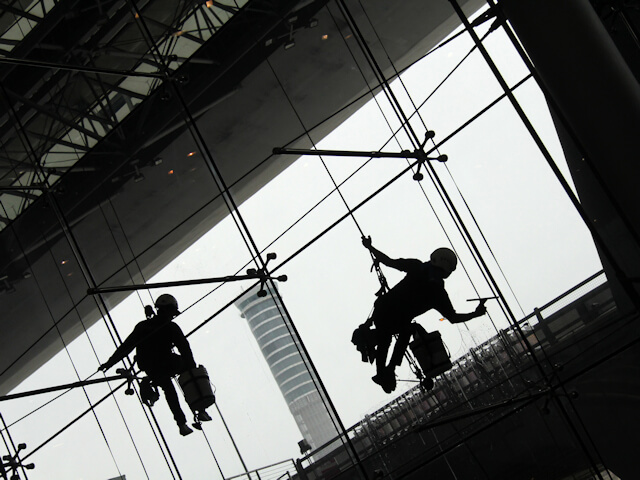 Silhouette of Window Cleaners